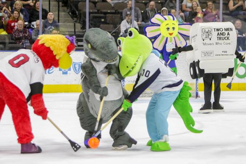 Fridgie and area mascots in broomball match